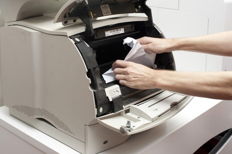 papel preso na impressora